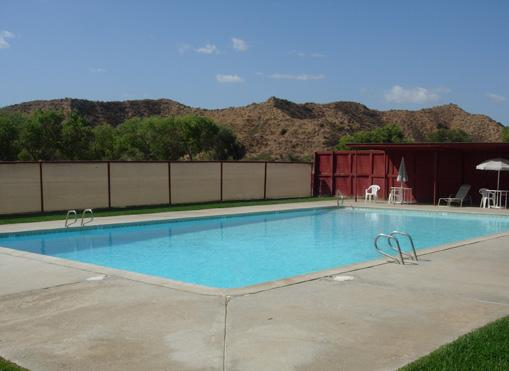 Situated right behind the bunkhouse you will find our swimming pool, tennis/basketball court, and the fort and playground.