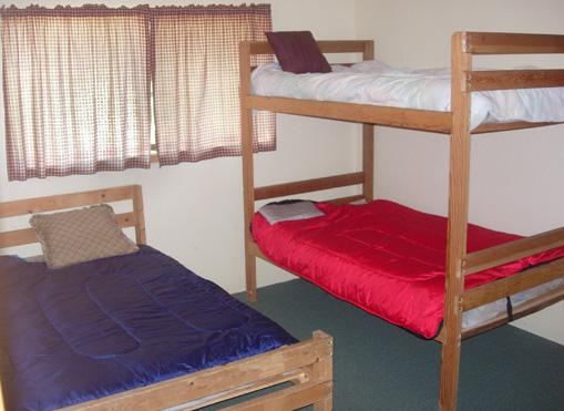 Each room has a closet, full and twin bunk bed.